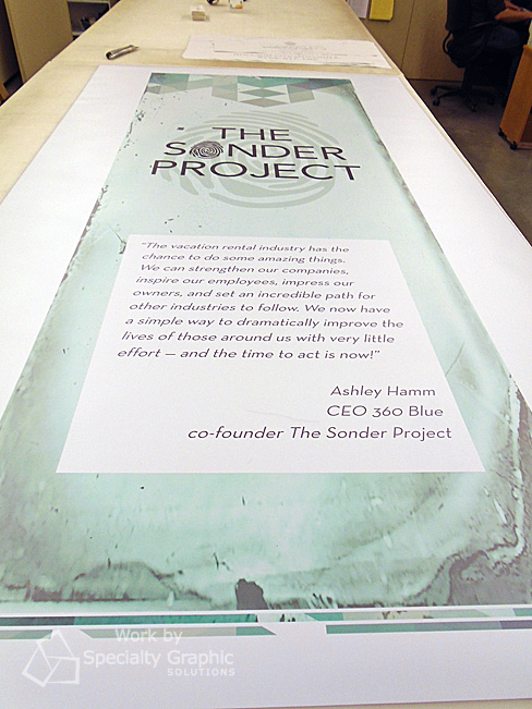 Pull up banner graphics fresh off the printer and awaiting installation in a retractable banner stand.jpg