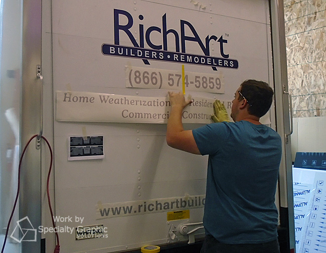Installing graphics on new box truck for Richart Builders Vancouver WA.jpg
