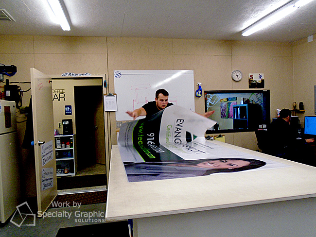 Mighty Sign Maker Taylor works magic on a digitally printed 8' banner, Vancouver WA.jpg