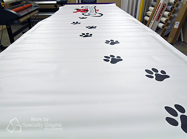 Prepping digitally printed banner that is almost 25 feet long!.jpg