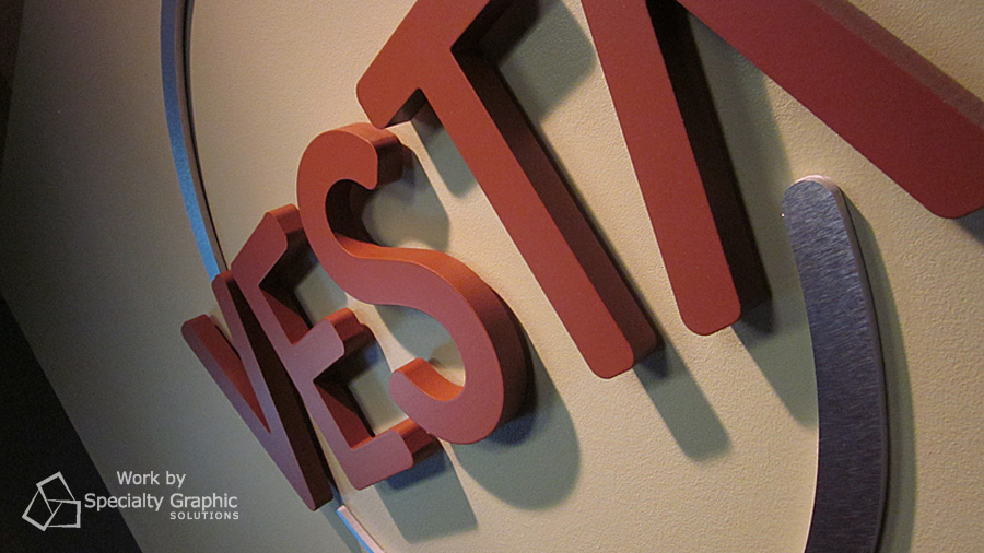 raised logo letter reception sign vesta.jpg