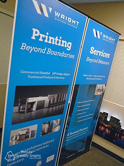 Informational displays using retractable banner stands