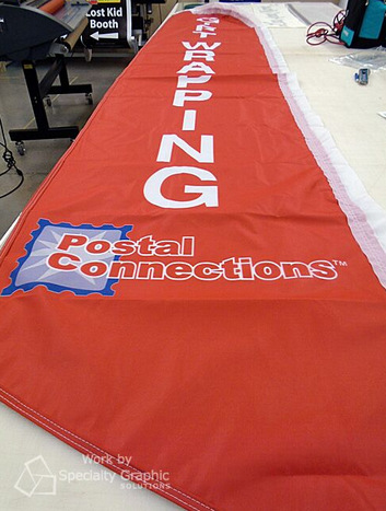 Swoper flags for retail stores in Portland Oregon