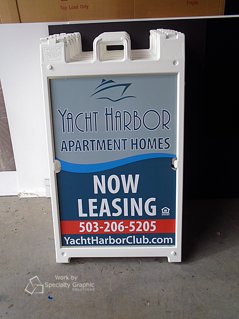 Sandwich board signs advertise apartments for lease.jpg