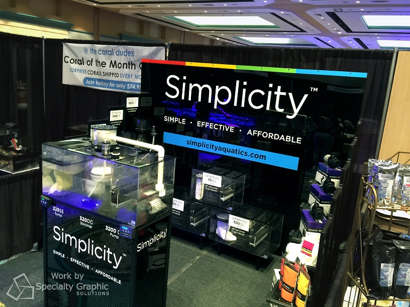 Vinyl graphics pop on black acrylic trade show display for Simplicy Aquatics.jpg