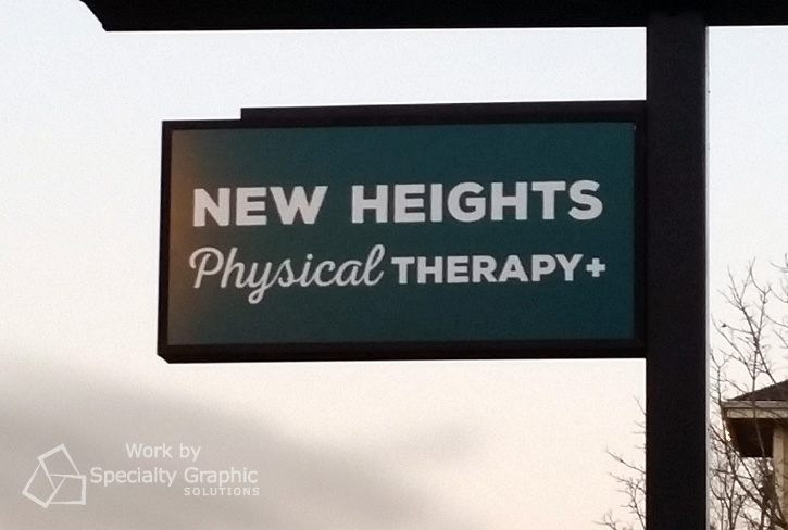 Double sided sign for New Heights Physical Therapy Portland OR.jpg