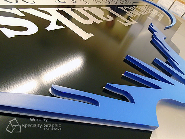 Mounting PVC logo pieces on bushed silver ACM sign panel.jpg