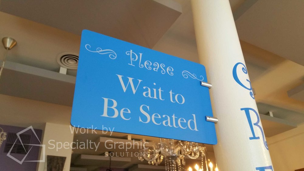 Please wait your turn to be seated pole sign.jpg