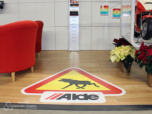 Floor graphics at trade show for Alde.