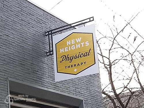 Double sided blade sign for New Heights Physical Therapy in Portland OR
