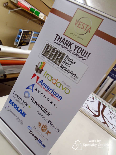 Vesta uses a table top banner to showcase sponsors for an event.