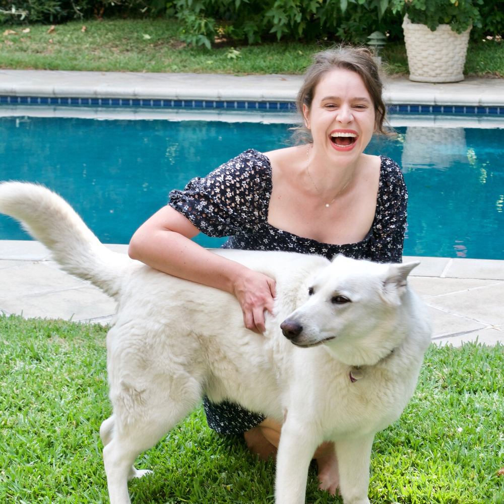Here's a picture of me with a large white dog! Do you like dogs?