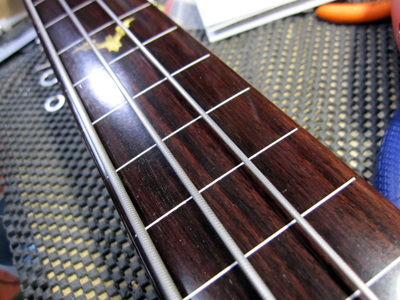 Fretless conversion with white plastic fret markers