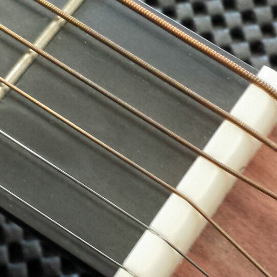 These strings are worn out and should be replaced. The bronze has turned brown/black in areas. New strings will sound much better. Click for larger image.