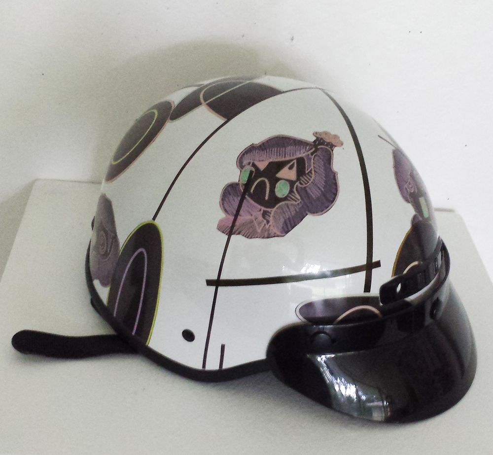2016. Vinyl stickers printed on latext printer and then adhered onto scooter helmet.