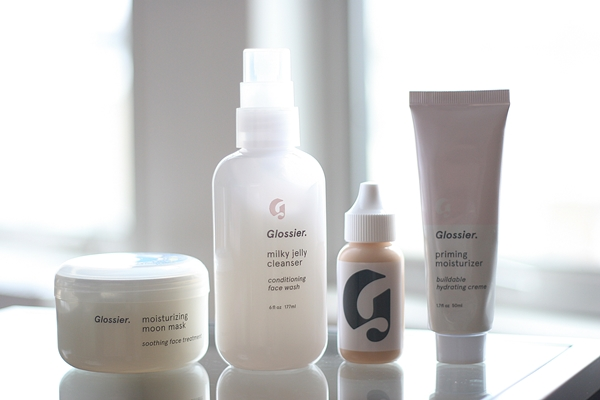 From left: Glossier Moisturizing Moon Mask, Milky Jelly Cleanser, Perfecting Skin Tint in Medium, Priming Moisturizer.