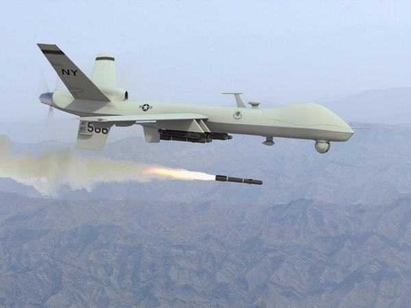 A Predator drone launches a Hellfire missile. Courtesy Militaryaerospace.com
