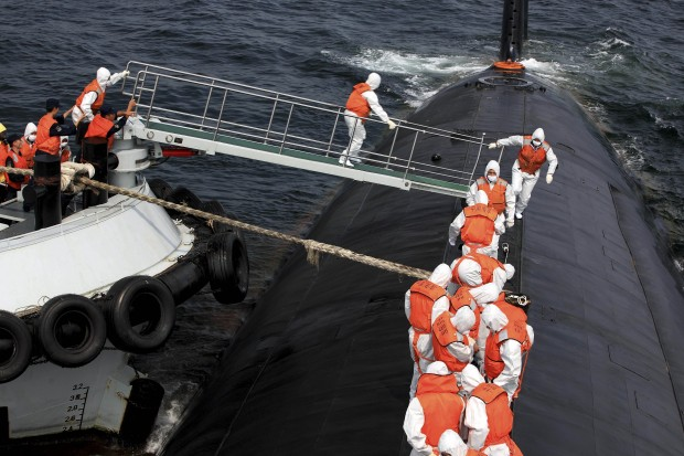 Chinese sailors participate in a safety drill aboard a nuclear submarine off the east coast of China. Courtesy Associated Press