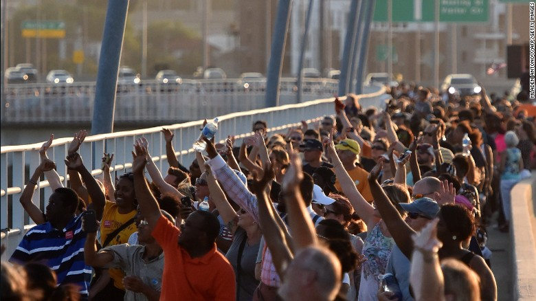 Thousands of residents in Charleston, South Carolina march in unity across the Arthur Ravenel, Jr. Bridge. Courtesy CNN