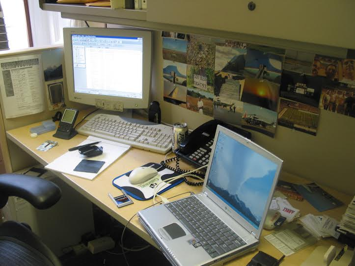 A lonely desk in the Office of Presidential Advance, circa 2002. Note Blackberry and StarTac belt clip.