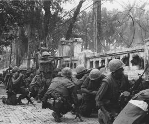 US Marines take cover from North Vietnamese snipers in Hue during the Tet Offensive. 1968. Courtesy UPI