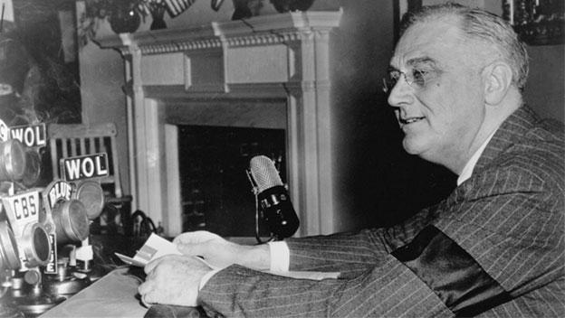 President Franklin D. Roosevelt delivers a fireside chat radio broadcast during World War II.