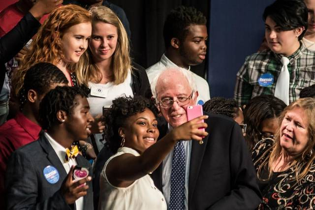 Sen. Bernie Sanders (D-VT) takes pictures with college students in South Carolina. Courtesy The State