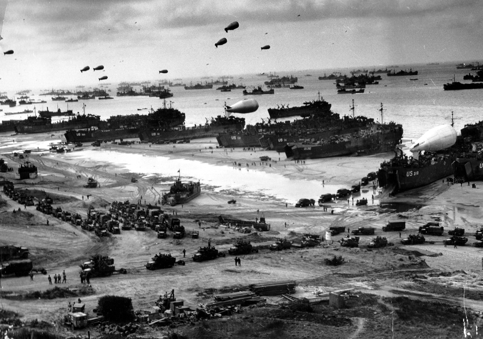 Allied forces offload men and machines in Normandy, 1944.