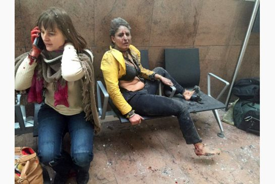 Injured flight attendant Nidhi Chaphekar in the aftermath of the Brussels Airport bombing. Courtesy AP.