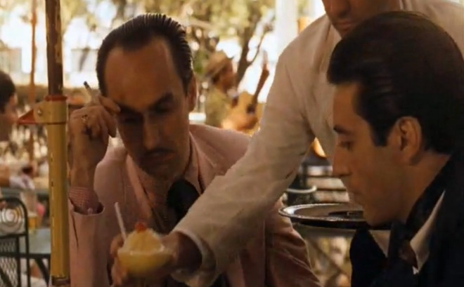 Fredo Corleone enjoys a banana daiquiri, with his brother, Michael.