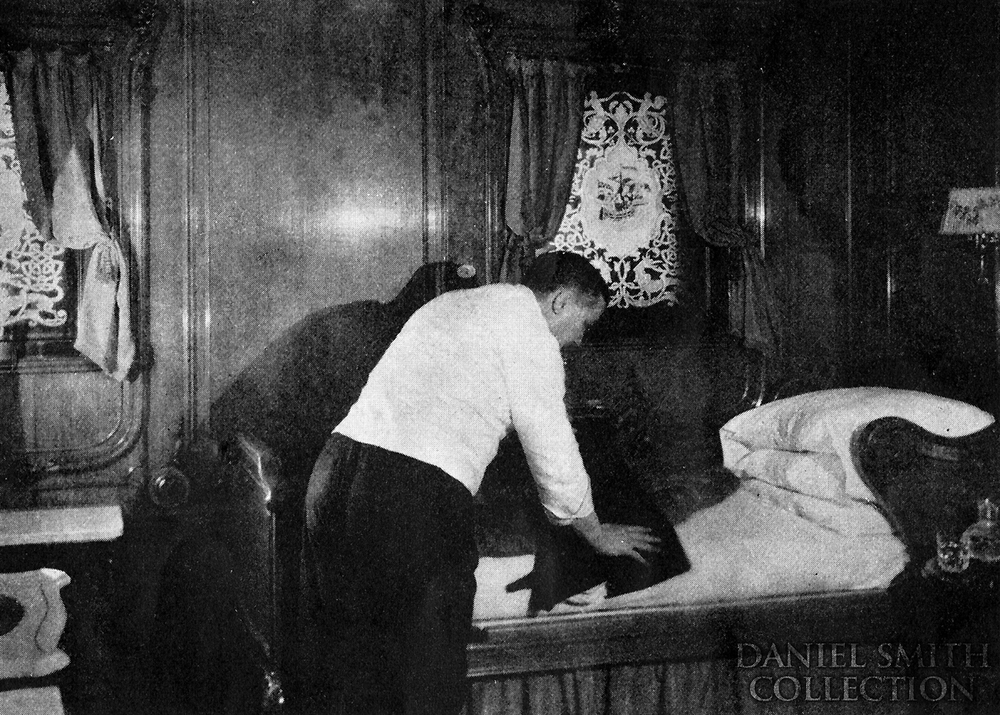 A first class steward tends to a stateroom on Olympic.