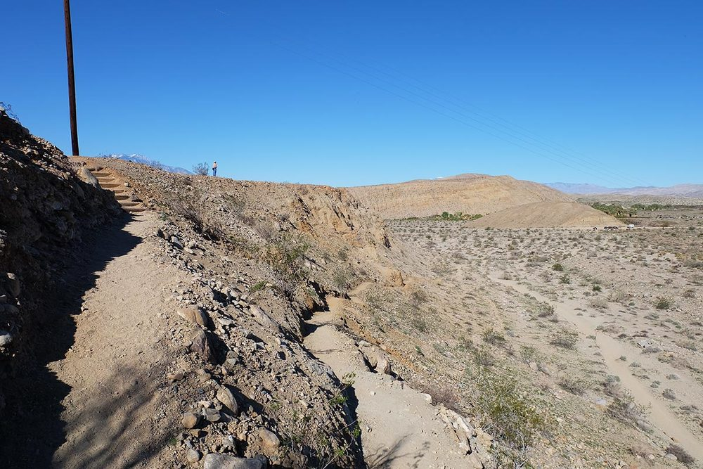 Looking back from the beginning of the trail: the visitor center and parking lot can be seen off to the right.