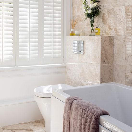 Beige-Marble-and-Shuttered-Bathroom-Ideal-Home-Housetohome.jpg