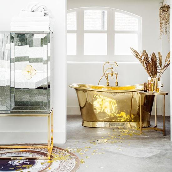 White-bathroom-with-brass-bath.jpg