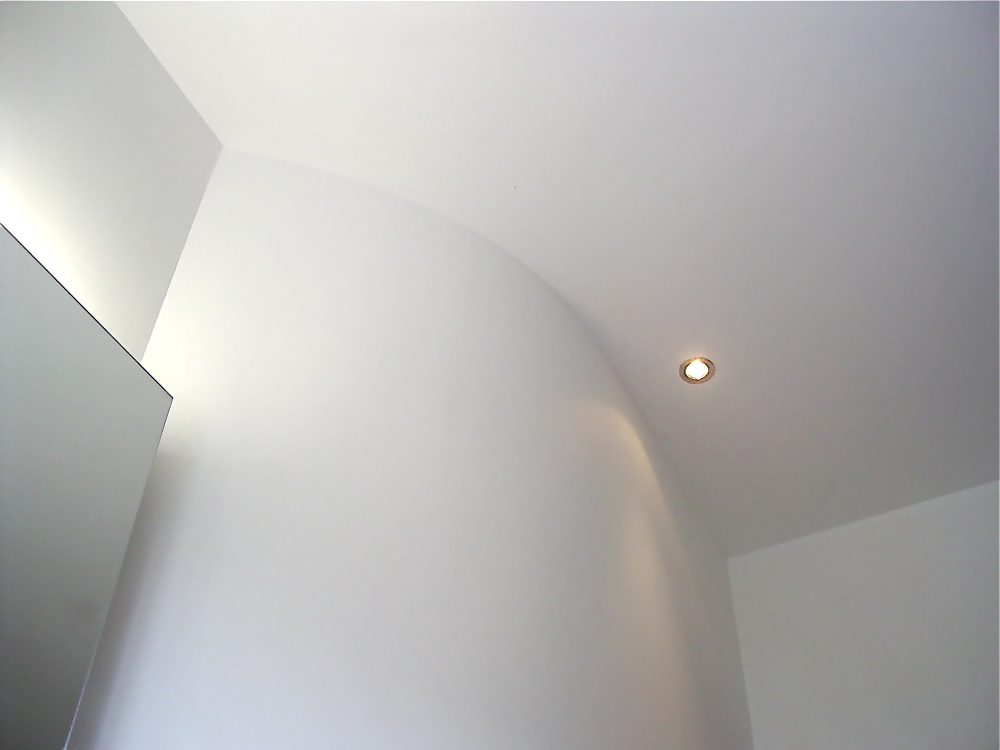 Bathroom refurbishment in Teddington with curved plastered walls and raised ceilings