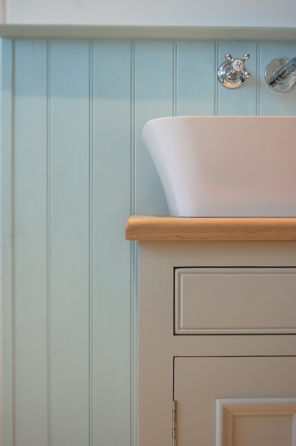 New period styling with wood panelling, stone composite basin from Clearwater and solid oak furniture by Neptune
