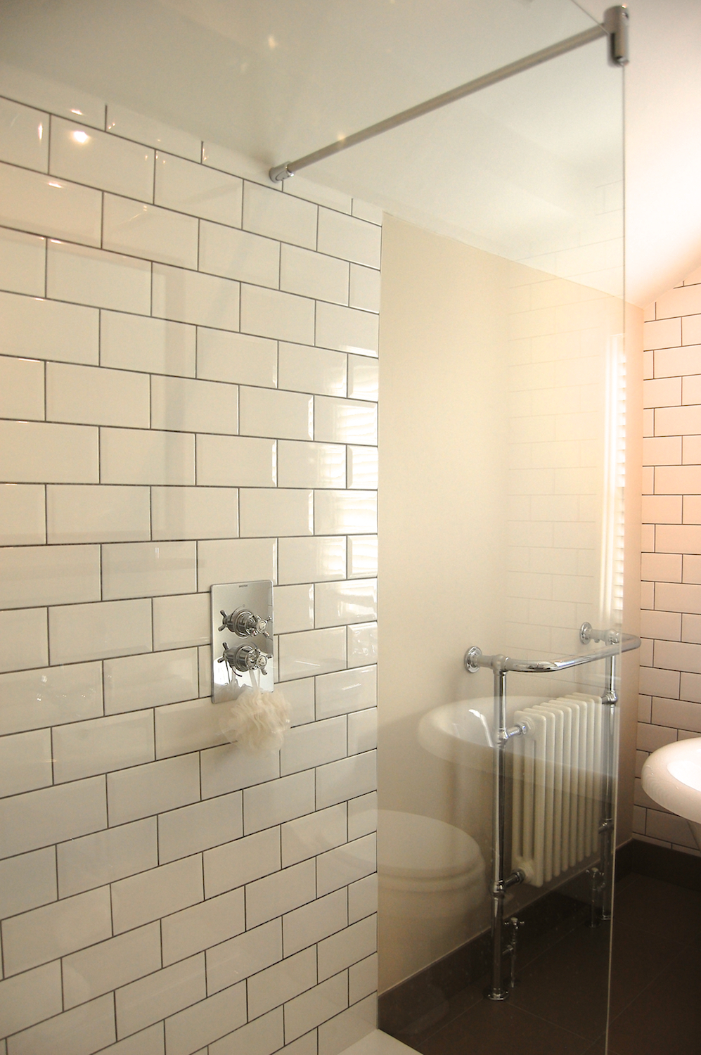 A character bathroom in Twickenham with metro tiles, porcelain floor, freestanding bath and large walk-in shower
