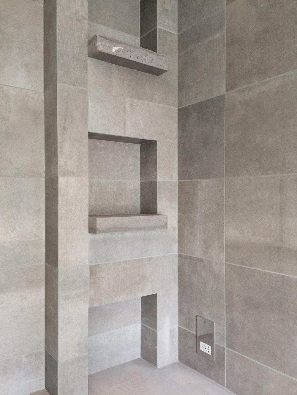 Mitered grey porcelain with hand-made cast concrete ledges