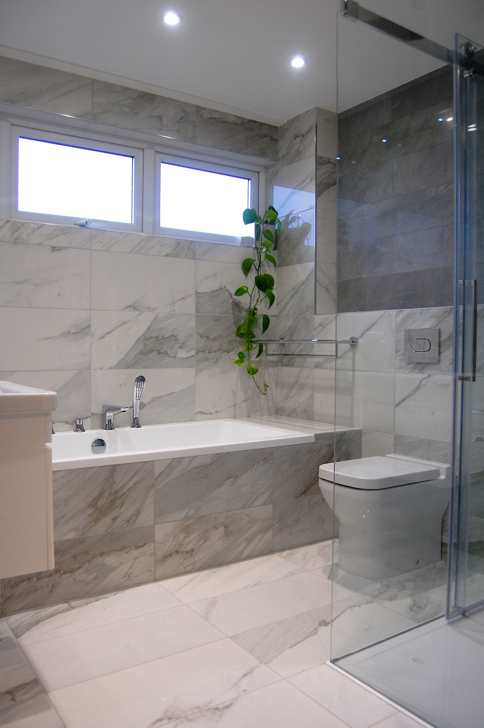 Retreat Bathroom in Windlesham, Ascot with Mandarin Stone, Saneux and Vado 754.jpg