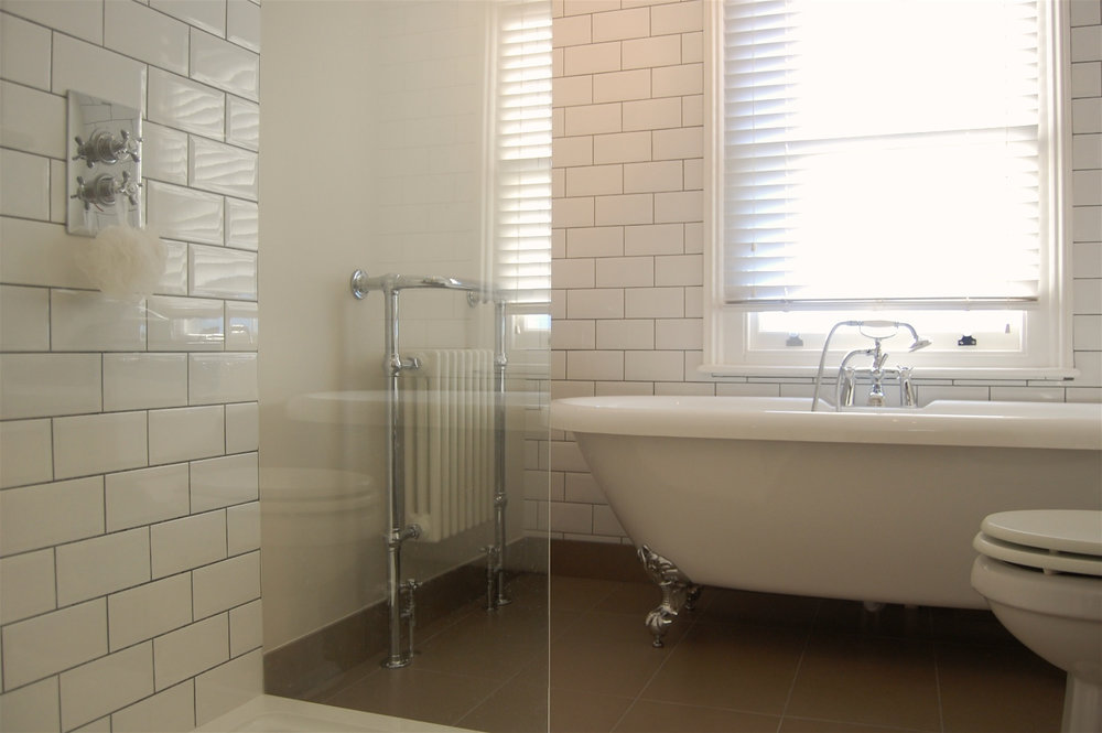 £8,600 - Family Bathroom with freestanding bath and large walk-in shower and metro tiles.