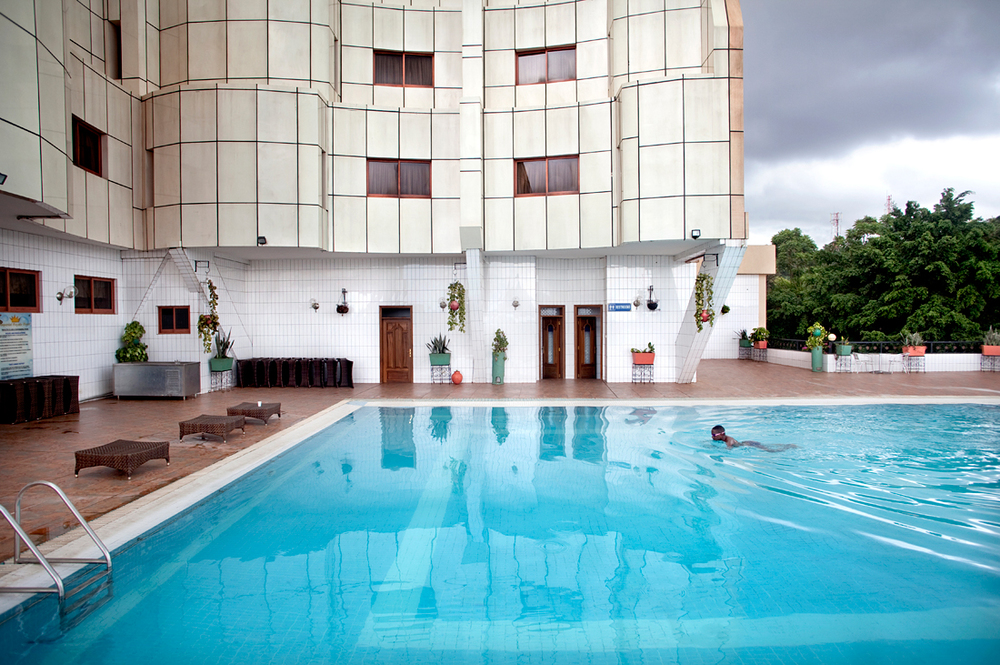 Kampala, Uganda.  Morning swim from an Ugandese business man.