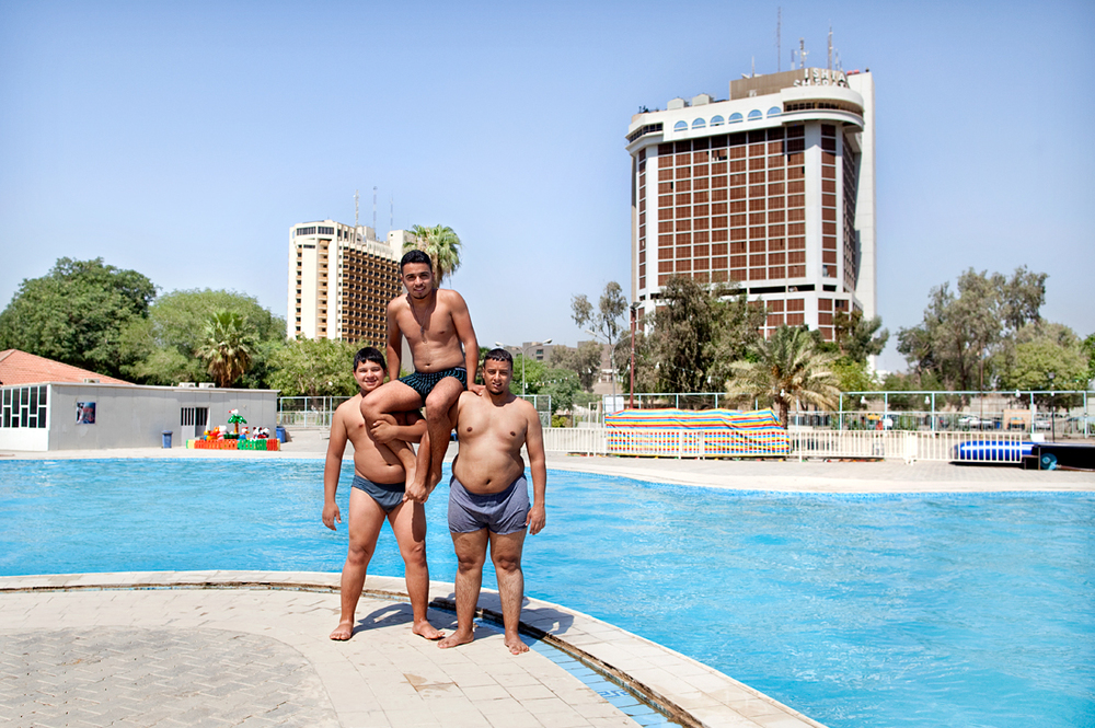 Baghdad, Iraq.  Boys playing acrobat at a pool near the Tigris river.