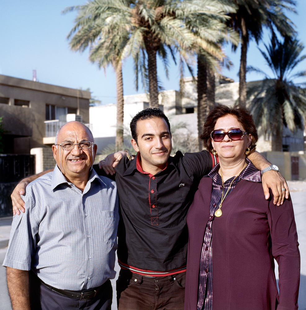 Mustafa with his mum and dad.