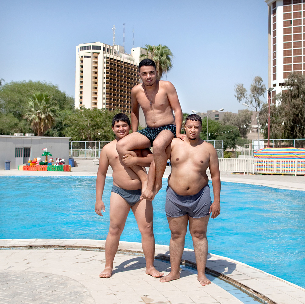 Boys at a swimming pool at one of the fish restaurants between the river Tigris en the busy Abu Nawas street.