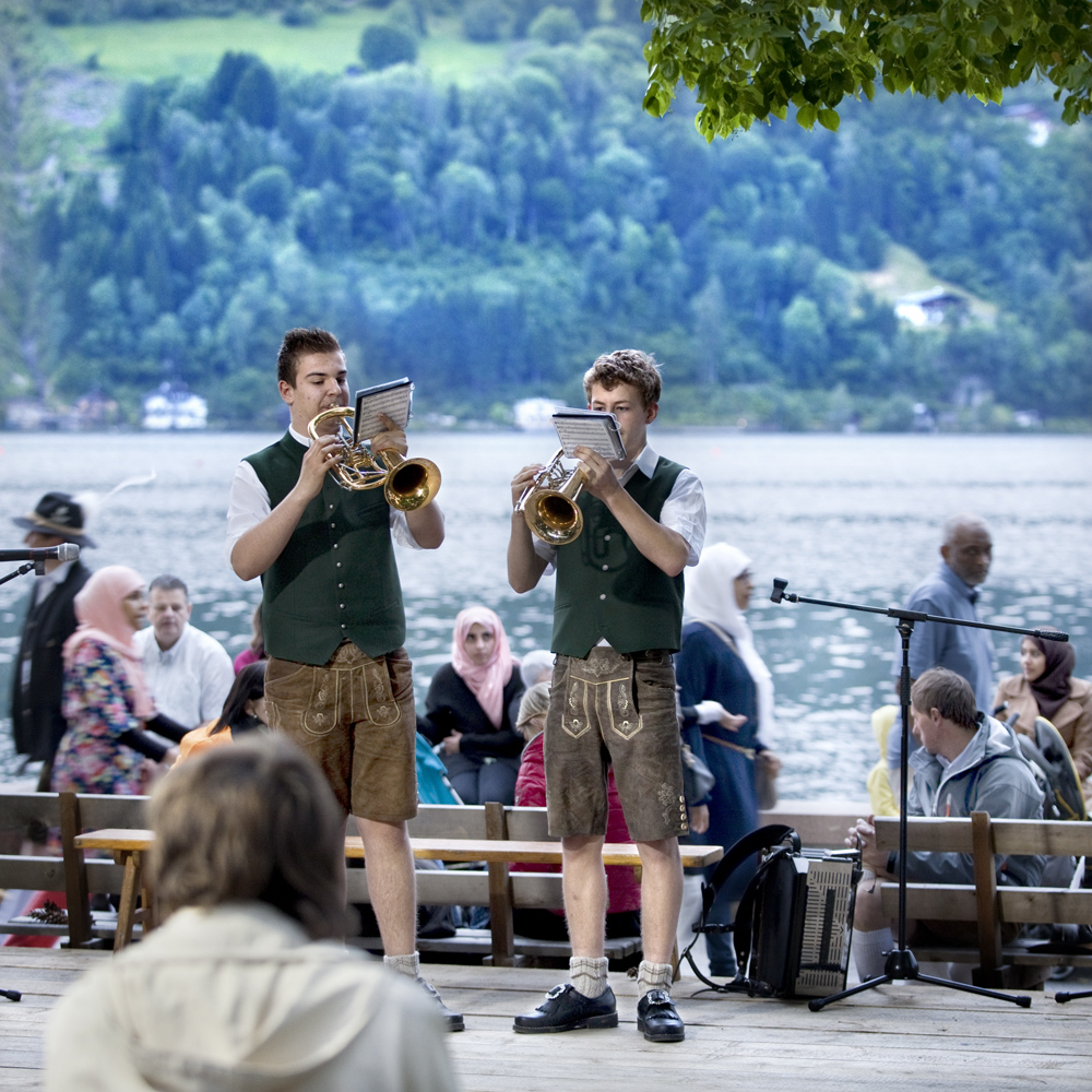 "At the weekly traditional feast ""Zell Edelweisen"" in the park by the lake local residents come together to dance and show their traditional costumes to the tourists.  There is also a yodelling and wood chopping contest."