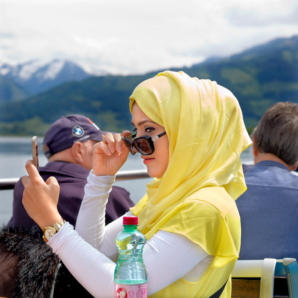 Fouzia (financial accountant) from Oman is here on holiday with her husband Hatam and they have been together for eight years.  While other tourists are enjoying a beer or having some ice cream, they are drinking hot chocolate topped with whipped cream.