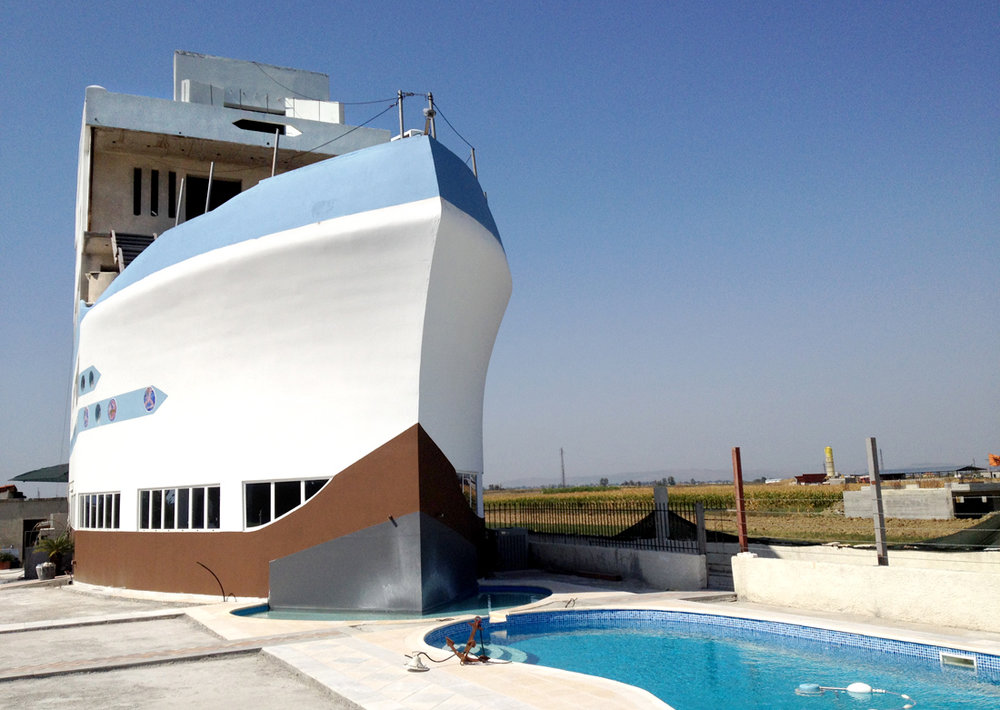 Neighborhood of Elbasan, Albania.  This Albanian family has designed their house like a ship.