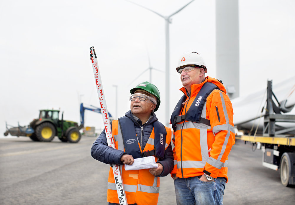 Entrepreneurs working on a project of the construction of windmills.    Use: Advertising   Cliënt: Eneco