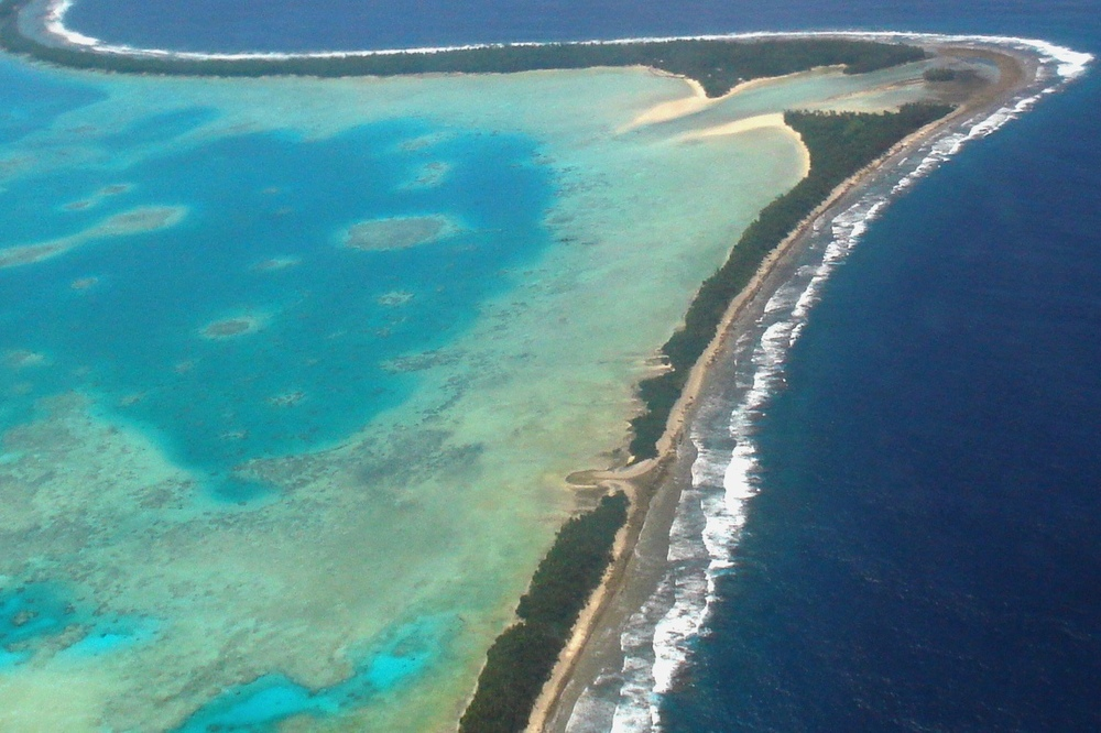 Aerial view of Tuvalu's capital, Funafuti, 2011. Tuvalu is a remote country of low lying atolls, making it vulnerable to climate change. Photo Credit: Lily-Anne Homasi/DFAT (cc-by-2.0)