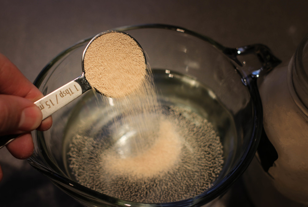 1.5 Tablespoons Dry Active Yeast: Re-hydrate in 3 cups of warm (~100 degree) water. Dump, stir, sit 5 min.